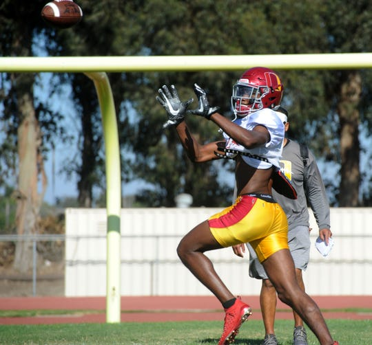 Oxnard High wide receiver J.R. Waters gets ready to make a catch at Wednesday's practice.