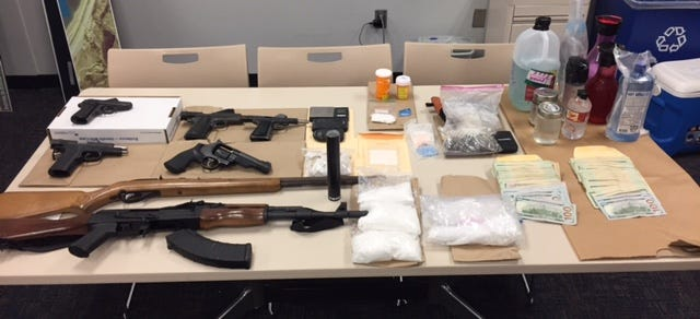 Authorities said they found methamphetamine, heroin, gamma hydroxybutyric acid, digital scales, packaging materials, pay records, cash and guns at the Van Nuys home of Richard Kevin Riley, 47.