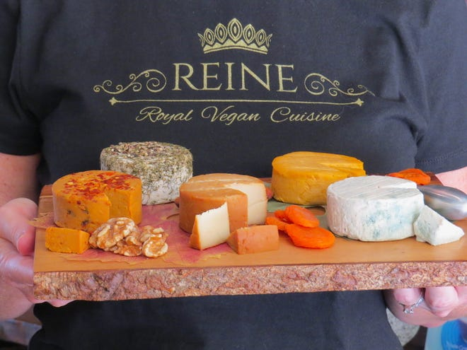 "Michelle Street, a dietitian and co-founder of Reine Vegan Cuisine, poses with a board of cashew-milk ""nut rounds"" made by the Ventura-based company. ""We called on our food chemistry (and) microbiology background and guidance from the artisan dairy industry to help us learn the techniques required to create an authentically produced artisanal aged cheese, only without dairy,"" Street says."