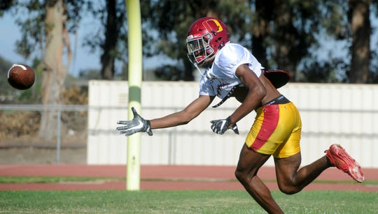 Oxnard wide receiver J.R. Waters, who is headed to Oregon, is one of several area high school football standouts who have earned scholarships to top college programs.