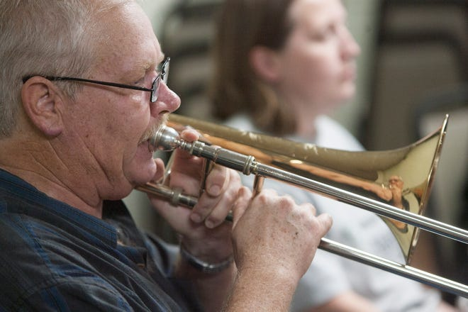 Dean Adams plays his trombone during a rehearsal with the Ventura Jazz Orchestra. The band is celebrating its 10th anniversary with a concert on Sept. 7 at the Poinsettia Pavilion. Adams is the band director.