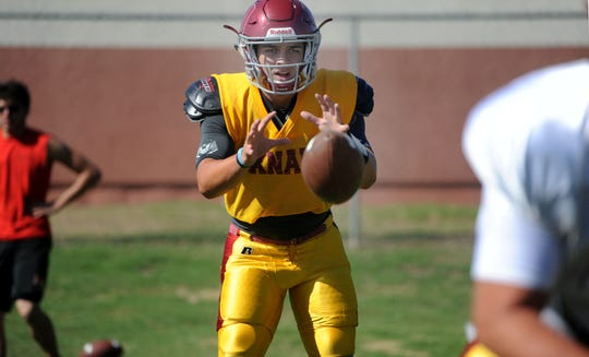Oxnard quarterback Vince Walea takes a snap during Wednesday's practice. The Yellowjackets will face Westlake on Friday night in a big road test early in the season.