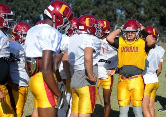 Oxnard quarterback Vince Walea listens for the play call during Wednesday's practice.