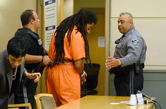 Michael L. Elliott, 25, is led out of a pre-trial detention hearing at the Cumberland County Court House on Thursday, August 30. Elliott has been charged with murder for the killing of 9-year-old Jennifer Trejo of Bridgeton.