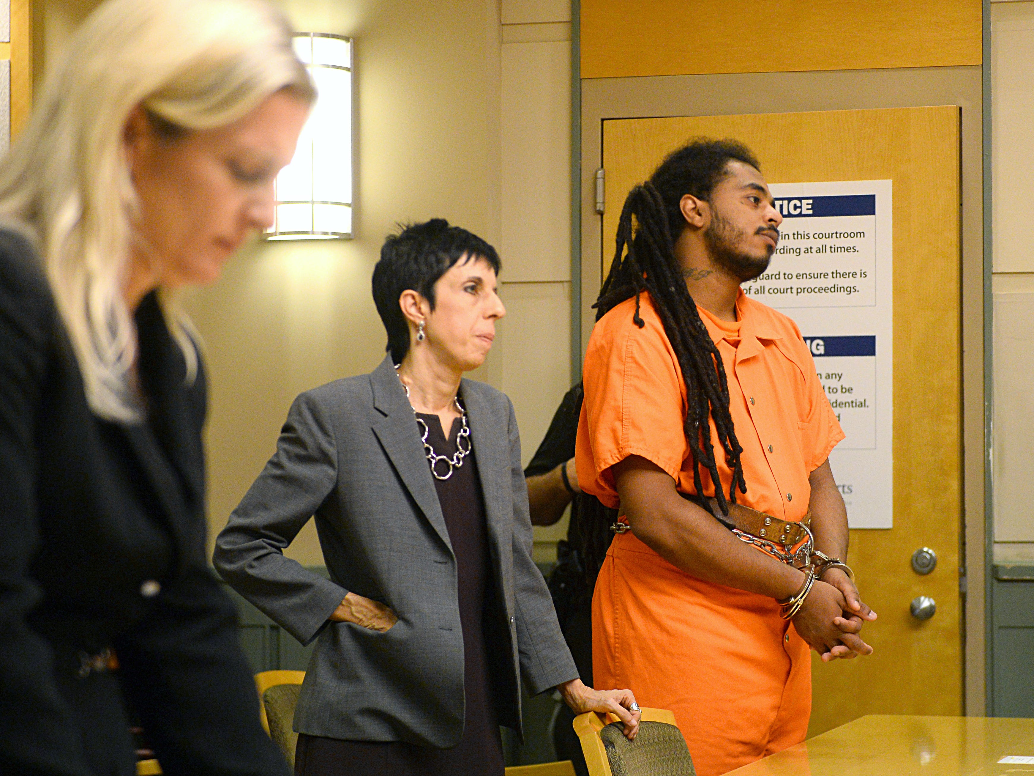 Michael L. Elliott, 25, stands with his attorney, Teresa M. Ganim, during a pre-trial detention hearing on Thursday, August 30. Elliott has been charged with murder for the killing of 9-year-old Jennifer Trejo.