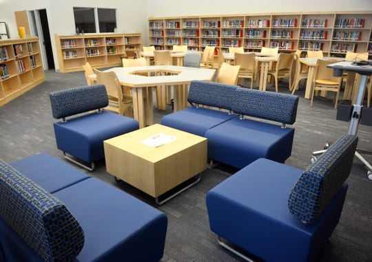 The Lincoln Avenue Middle School media center features various seating areas where students can collaborate or enjoy some individual reading time.
