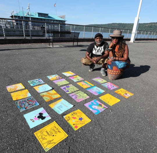 Evan Bishop and Katori Walker, co-founders of the Yes Yonkers community quilt project, are pictured Aug. 30, 2018, with some of the hand painted canvas panels that will be assembled into a quilt.