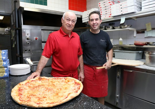 Owners Franco Pulitano, left, and his son Al Pulitano at Franco's Pizza in Nanuet Aug. 30, 2018. The eatery, owned by Franco and his two sons Al and Frank Jr., is moving down the road to a new location in the fall.