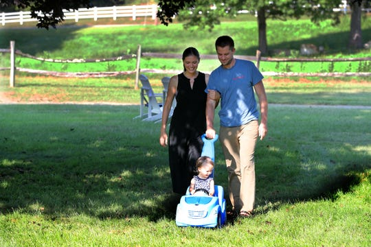 Herbert and Lydia Moore of Sharon, Conn. walk with their 16-month old daughter Charlotte Aug. 29, 2018. With Poughkeepsie-based Health Quest planning on closing the maternity ward at Sharon Hospital, the Moore's and other Connecticut residents who use Sharon Hospital are fighting to keep the maternity ward open, fearing that having to use a hospital much further away could pose life threatening dangers in the event of a medical emergency.