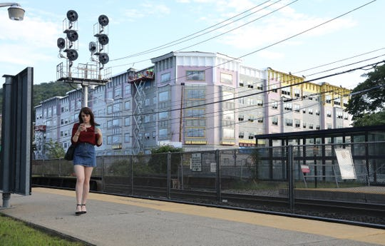 A commuter walks the platform at the Suffern train Station on Thursday, August 30, 2018.