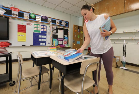 Mary Ann Maric, a new 6th grade special education teacher at the school, prepares the students desks at the Alice E. Grady Elementary School in Elmsford, Aug. 30, 2018.