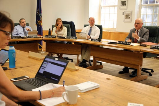Daniel Petigrow, right, from the Scarsdale school district legal counsel, speaks at a school board meeting to discuss IRS regulations on the deductibility of state and local taxes Aug. 29, 2018 at the district office.