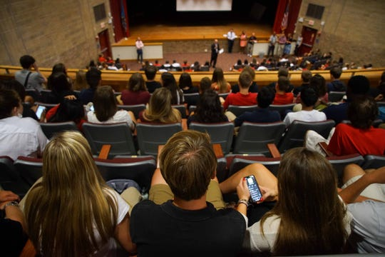 (center)Ryan Pirrung, 17, a senior at Conrad School of Science, listens to school year rules during an assembly on the first day of school.