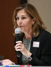 Kathy Jennings speaks as Democratic Attorney General candidates square off in a final forum at Delaware State University Wednesday ahead of next week's primary election.