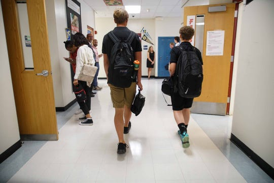 Ryan Pirrung, 17, a senior at Conrad School of Science, walks with  fellow students through the halls while changing classes on the first day of school.