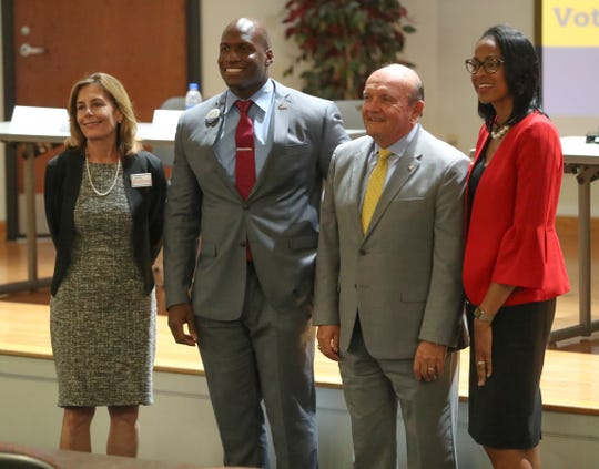 Democratic Attorney General candidates (from left) Kathy Jennings, Chris Johnson, Tim Mullaney and LaKresha Roberts gather for a photo after a final forum at Delaware State University Wednesday ahead of next week's primary election.