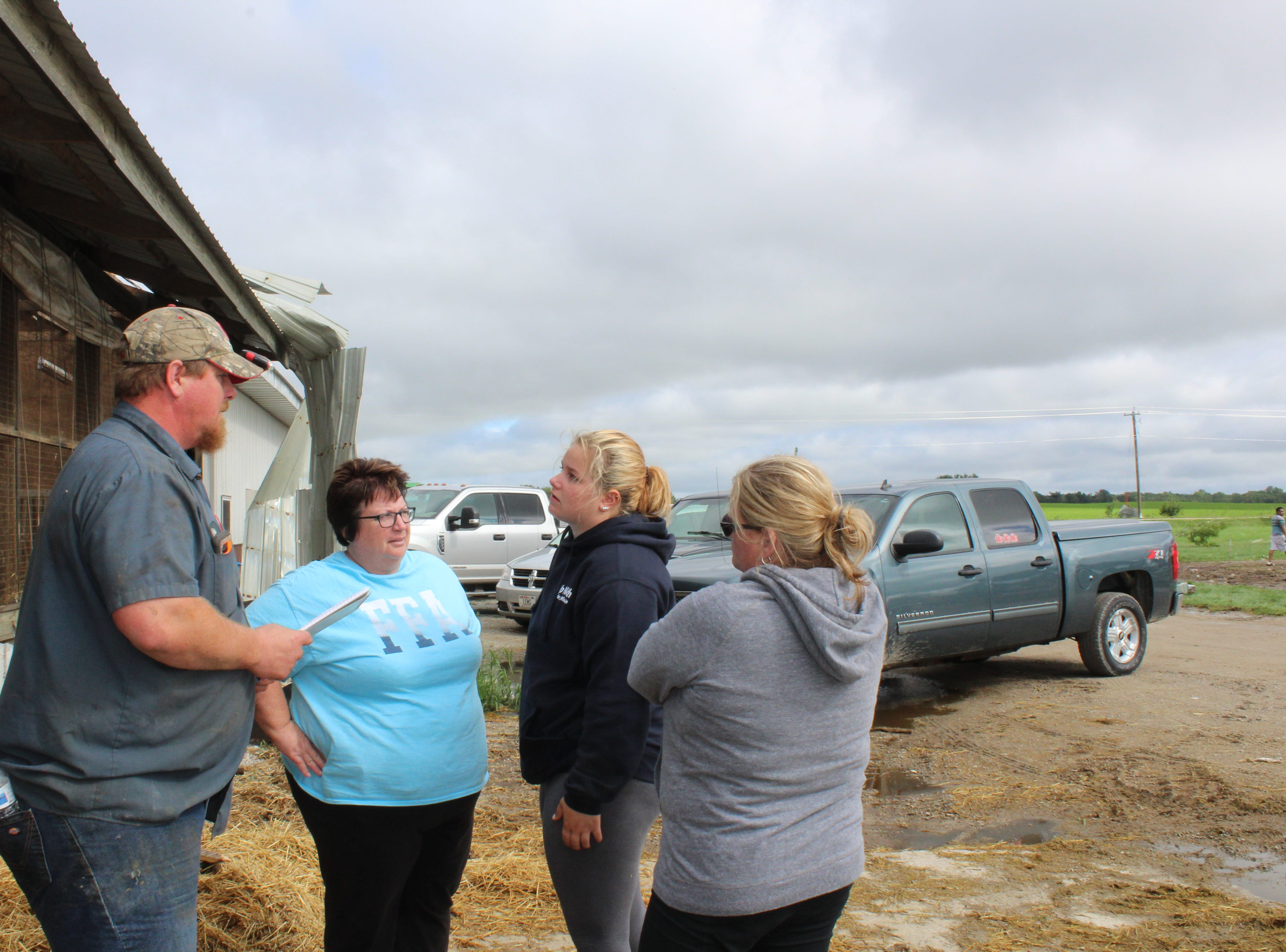 Liz Wetzel (center) reports to her father Eric Wetzel on the movement and condition of cattle from Pebble Knolls Dairy near Alto.