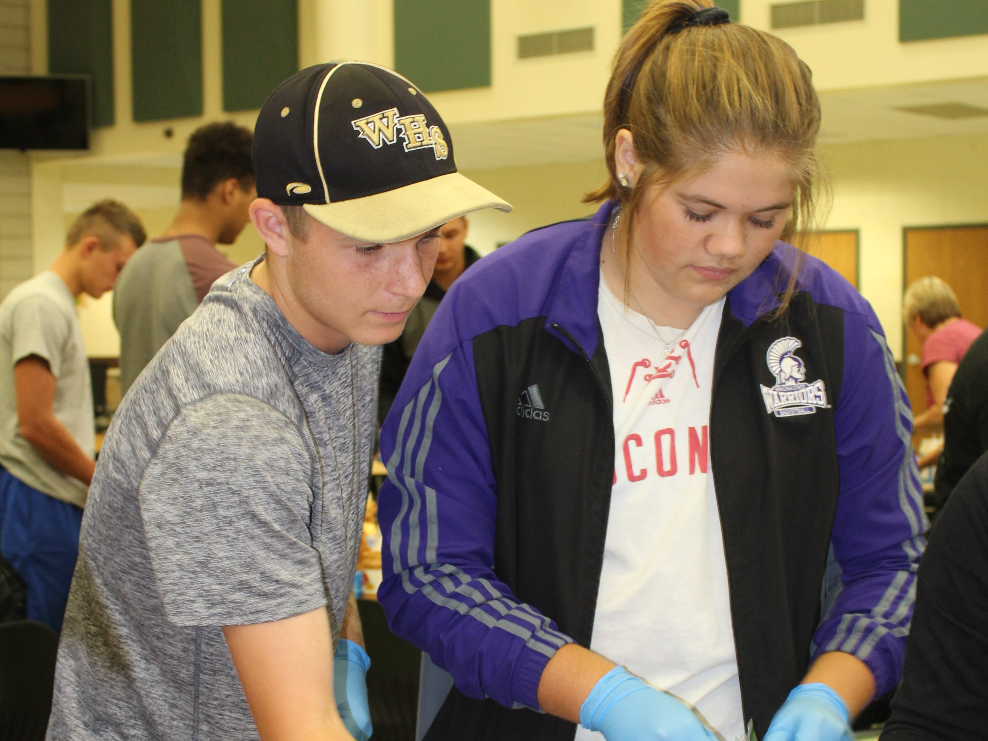 Waupun FFA volunteers help make sandwiches for utility workers and volunteers helping in the wake of a July 28 tornado.
