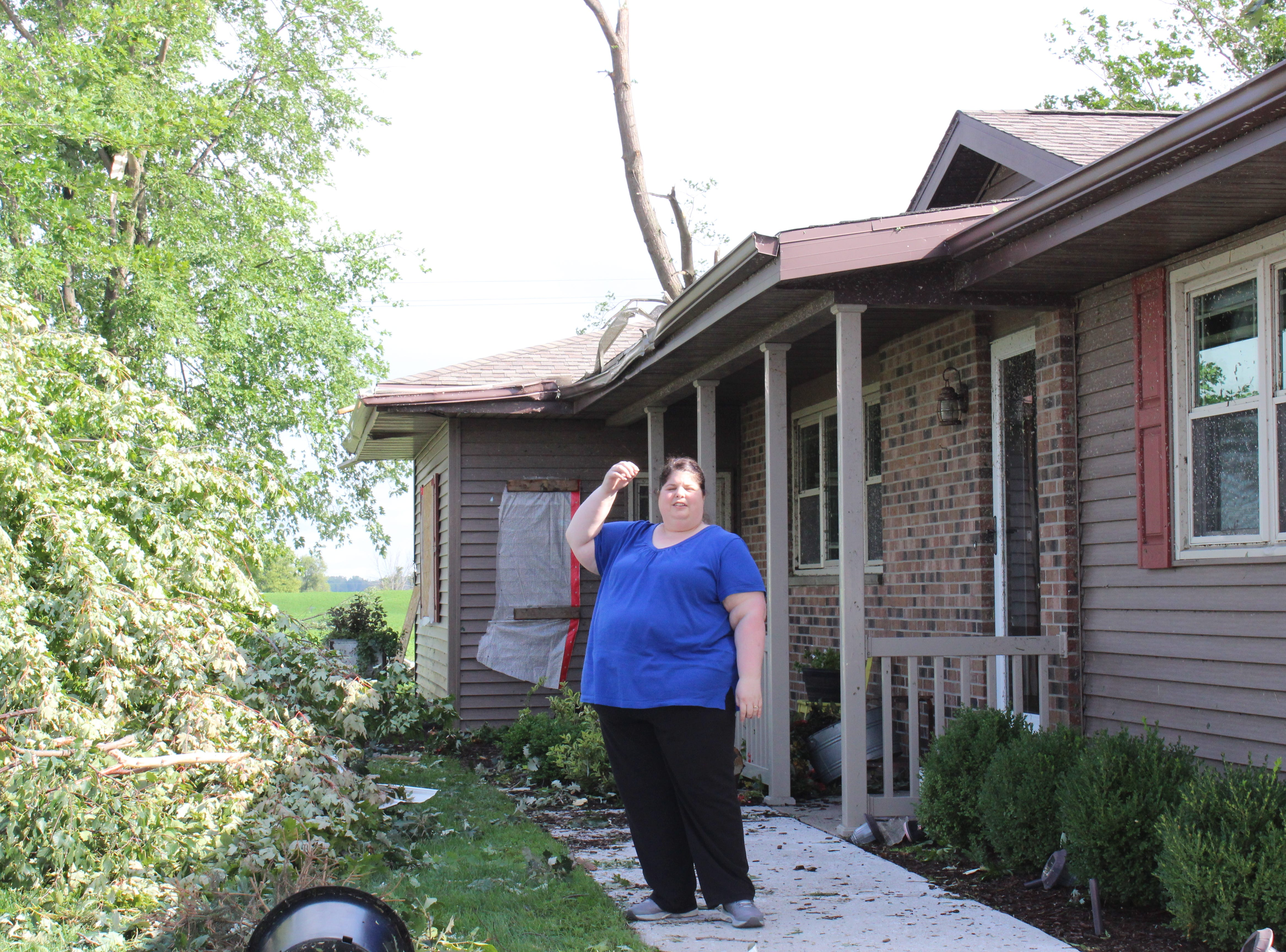 Michelle Wetzel said the strong winds drove two-by-four planks through the walls of her home.