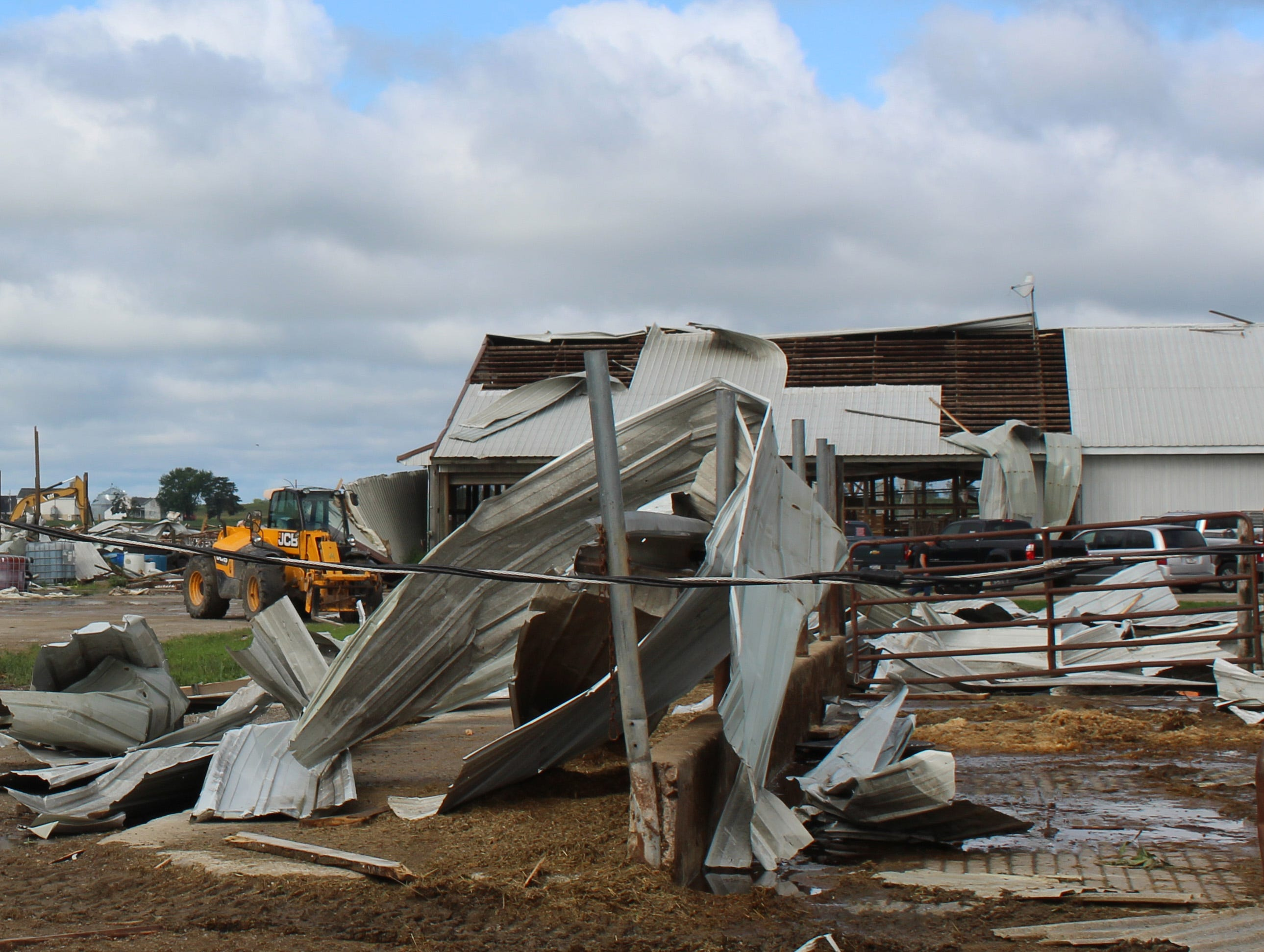 Six buildings including a large freestall barn that sheltered the milking herd at Pebble Knolls Dairy were destroyed in a tornado on July 28.