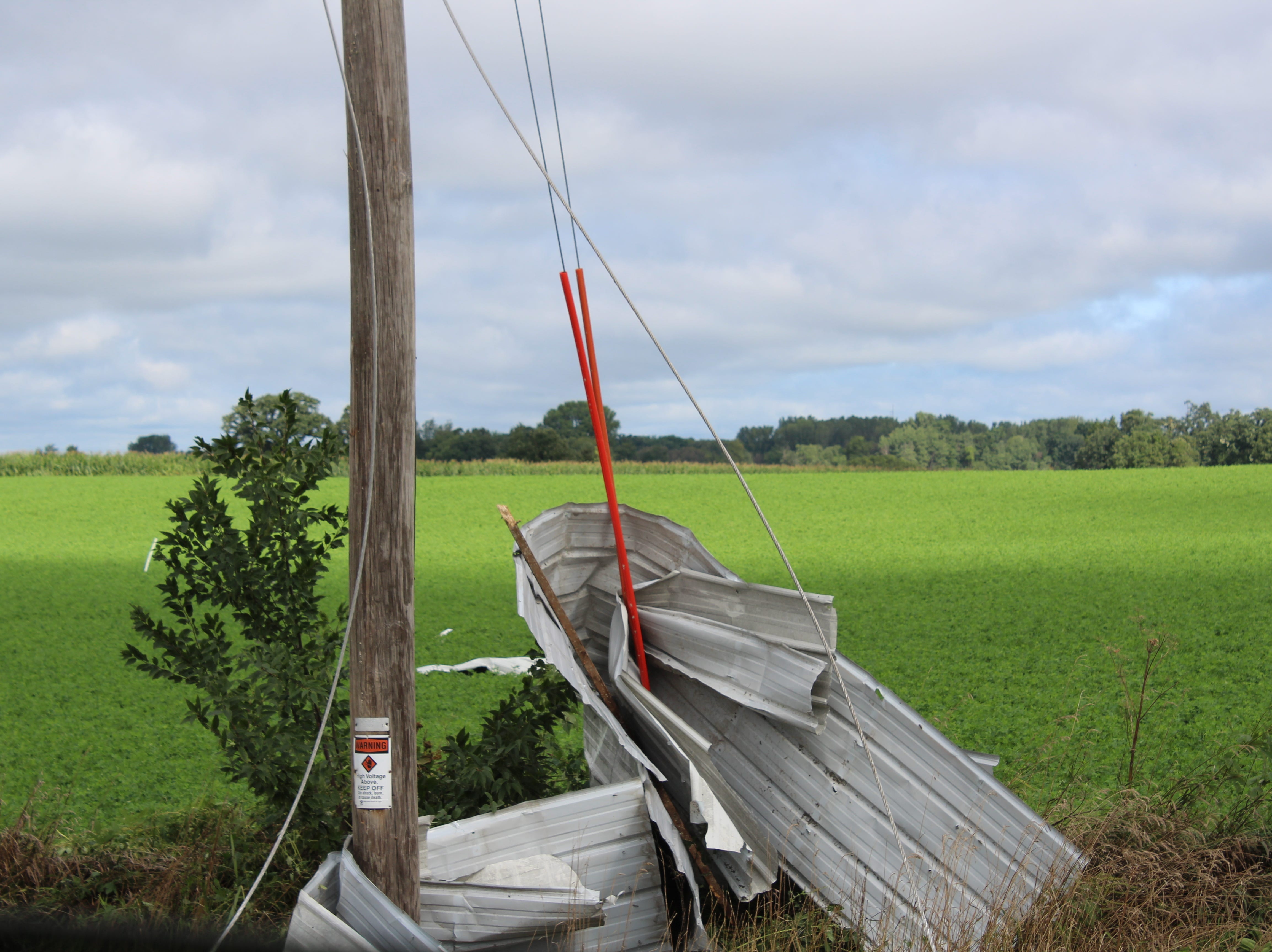 Sheet metal is bent around a utility pole across the road from the Wetzel farm.