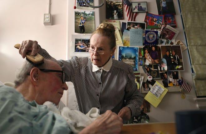 Helga Amidon visits her husband, Charles, a decorated veteran, at the VA nursing home Aug. 27 in Bedford, Mass.
