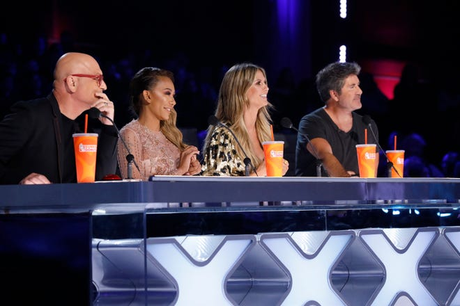 'America's Got Talent' judges Howie Mandel, left, Mel B, Heidi Klum and Simon Cowell watch an act during Tuesday's live performance show.