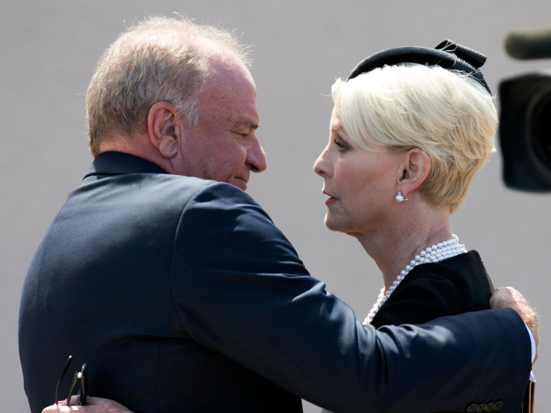 Grant Woods hugs Cindy McCain, wife of Sen. John McCain, following a memorial service for at North Phoenix Baptist Church in Phoenix, Aug. 30, 2018.