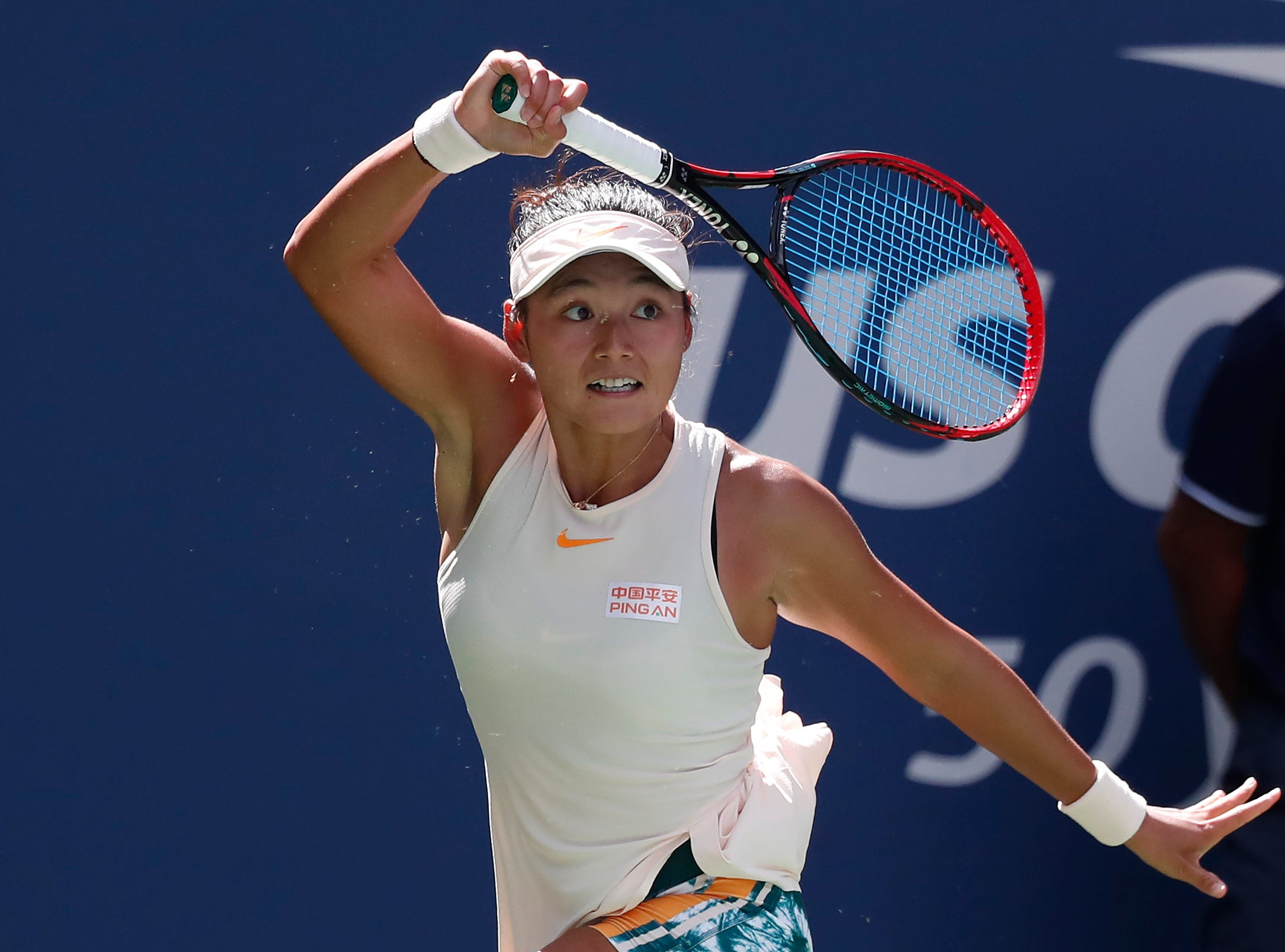 Yafan Wang of China hits a forehand against Petra Kvitova of Czech Republic.