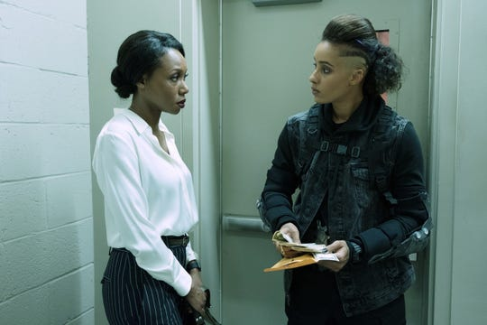 When she finds herself dealing with harassment and a glass ceiling at work, Jane (Amanda Warren, left) hires an assassin (AzMarie Livingston) on Purge night to level the playing field.