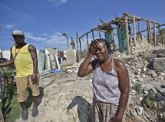 Cholera Marie Louse Valentin weeps in front of her home shattered by Hurricane Matthew in Morne la Source, Haiti, on Oct. 9, 2016.