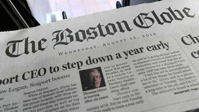 In this file photo taken on August 15, 2018 copies of the Boston Globe are seen at a newspaper stand in Boston, Massachusetts. Robert Chain, 68, of Encino, California, was arrested on August 30, 2018, and charged with one count of making threatening communications against employees of the Boston Globe, according to US Attorney's Office for the District of Massachusetts.