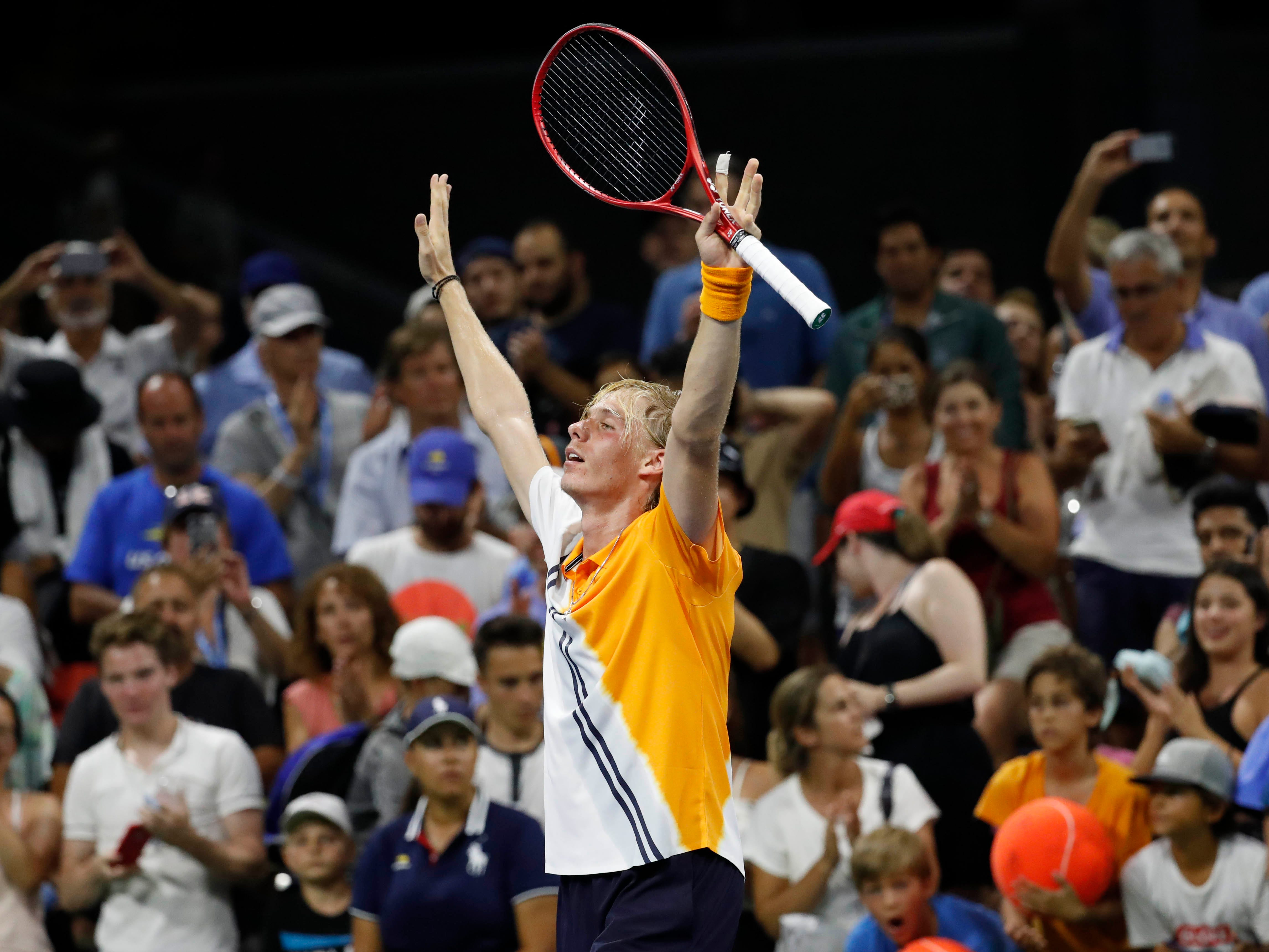 Denis Shapovalov of Canada celebrates after defeating Andreas Seppi of Italy in a five-set marathon.