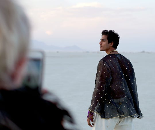 Nirav Nirvaan of Los Angeles poses for a photo at Burning Man taken by Helen Sartory of London.