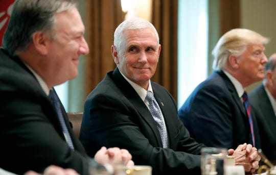 Secretary of State Mike Pompeo, left, smiles along with Vice President Mike Pence, as President Donald Trump speaks with Kenyan President Uhuru Kenyatta before a bilateral meeting in the Cabinet Room at the White House, Monday, Aug. 27, 2018, in Washington. (AP Photo/Alex Brandon) ORG XMIT: OTKAB