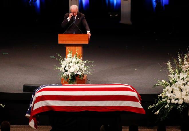 Former Vice President Joe Biden wipes a tear while giving a tribute during a memorial service or Sen. John McCain at North Phoenix Baptist Church in Phoenix, Aug. 30, 2018.