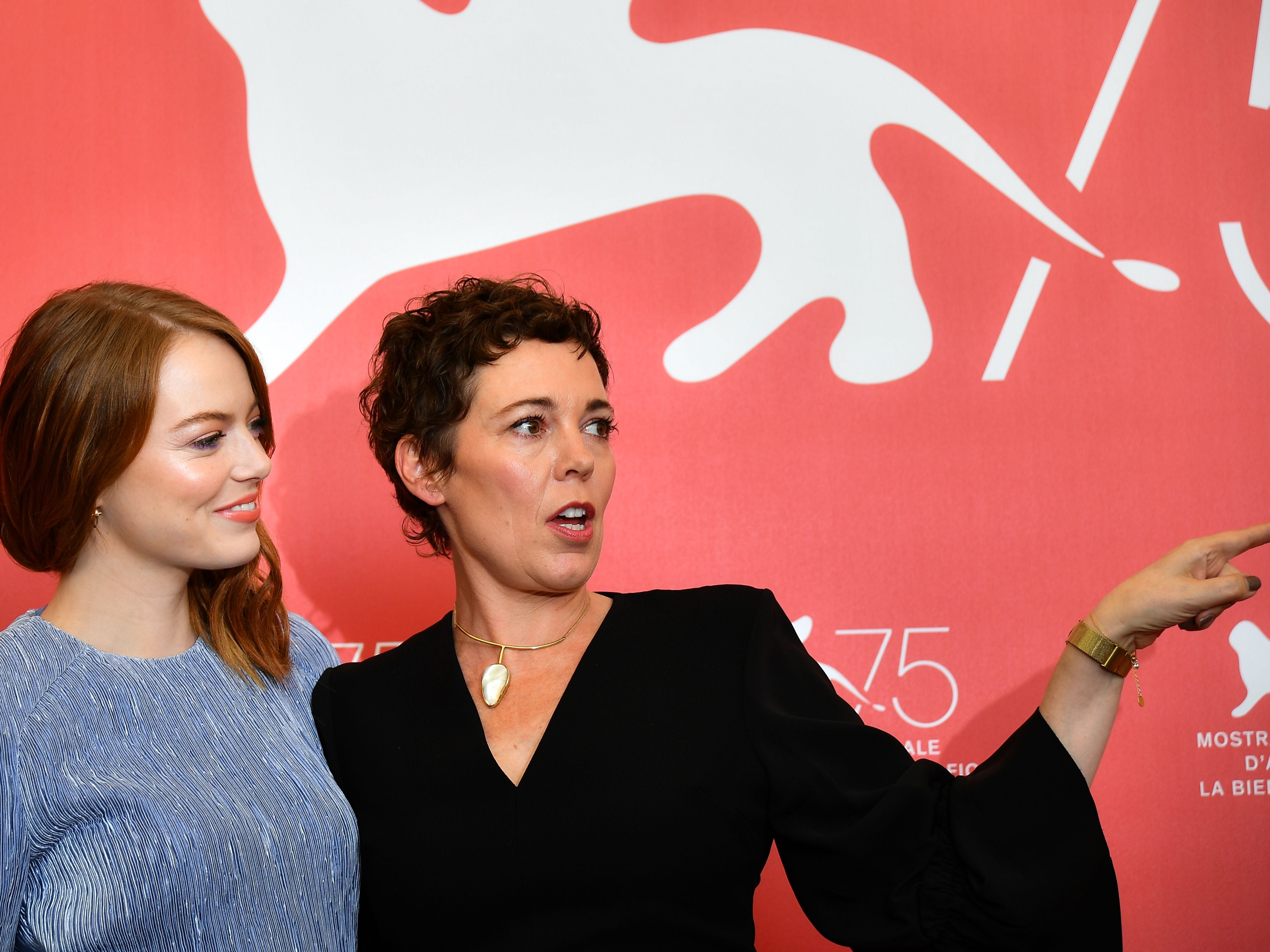 """Actress Emma Stone (L) and actress Olivia Colman attend a photocall for the film """"The Favourite"""" presented in competition on August 30, 2018 during the 75th Venice Film Festival at Venice Lido. (Photo by Vincenzo PINTO / AFP)VINCENZO PINTO/AFP/Getty Images ORIG FILE ID: AFP_18P8J2 x"""