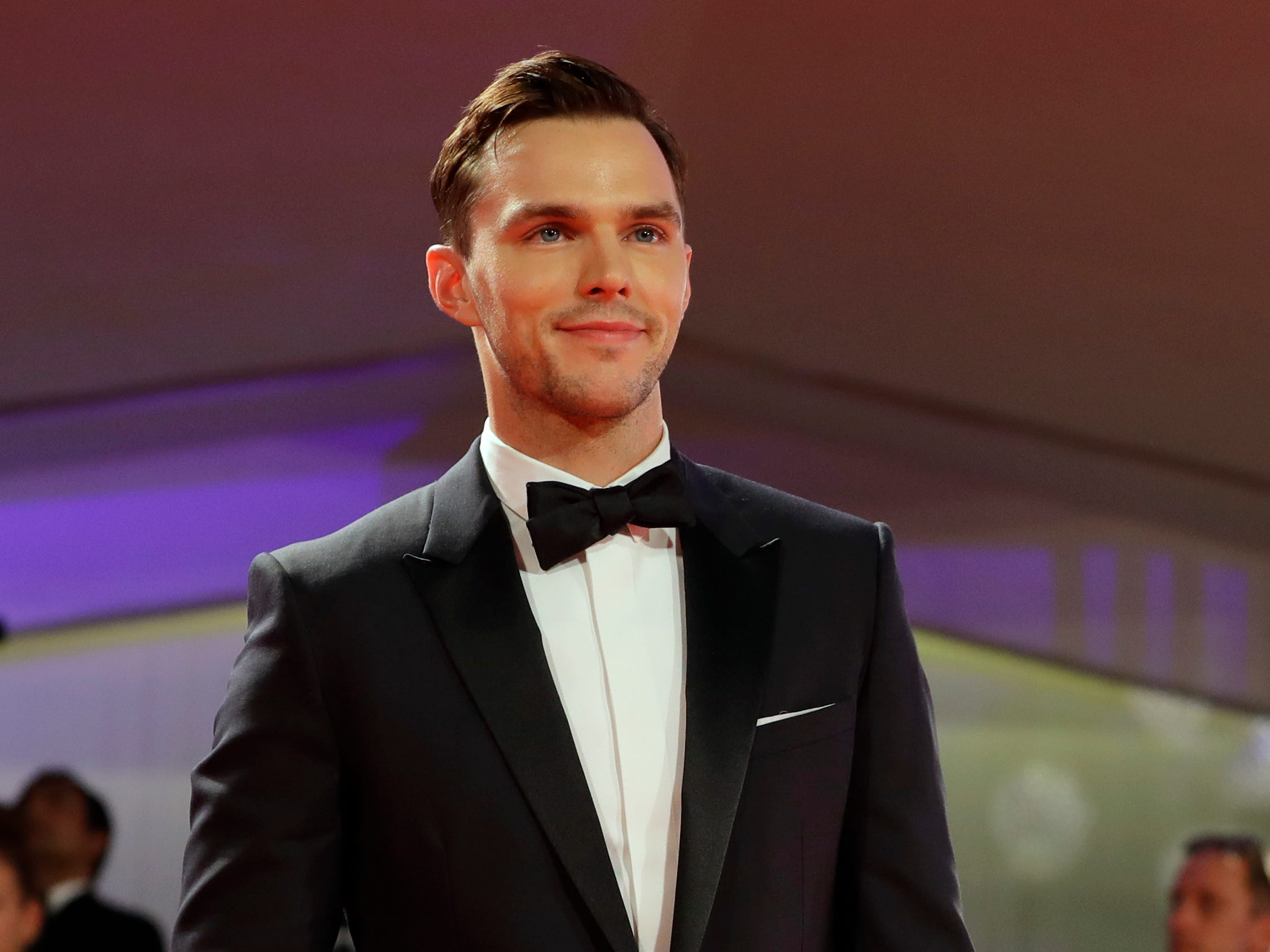 Actor Nicholas Hoult poses for photographers upon arrival at the premiere of the film 'The Favourite' at the 75th edition of the Venice Film Festival in Venice, Italy, Thursday, Aug. 30 , 2018.