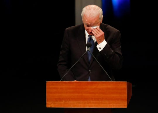 Former Vice President Joe Biden wipes a tear while giving a tribute during memorial service at North Phoenix Baptist Church for Sen. John McCain