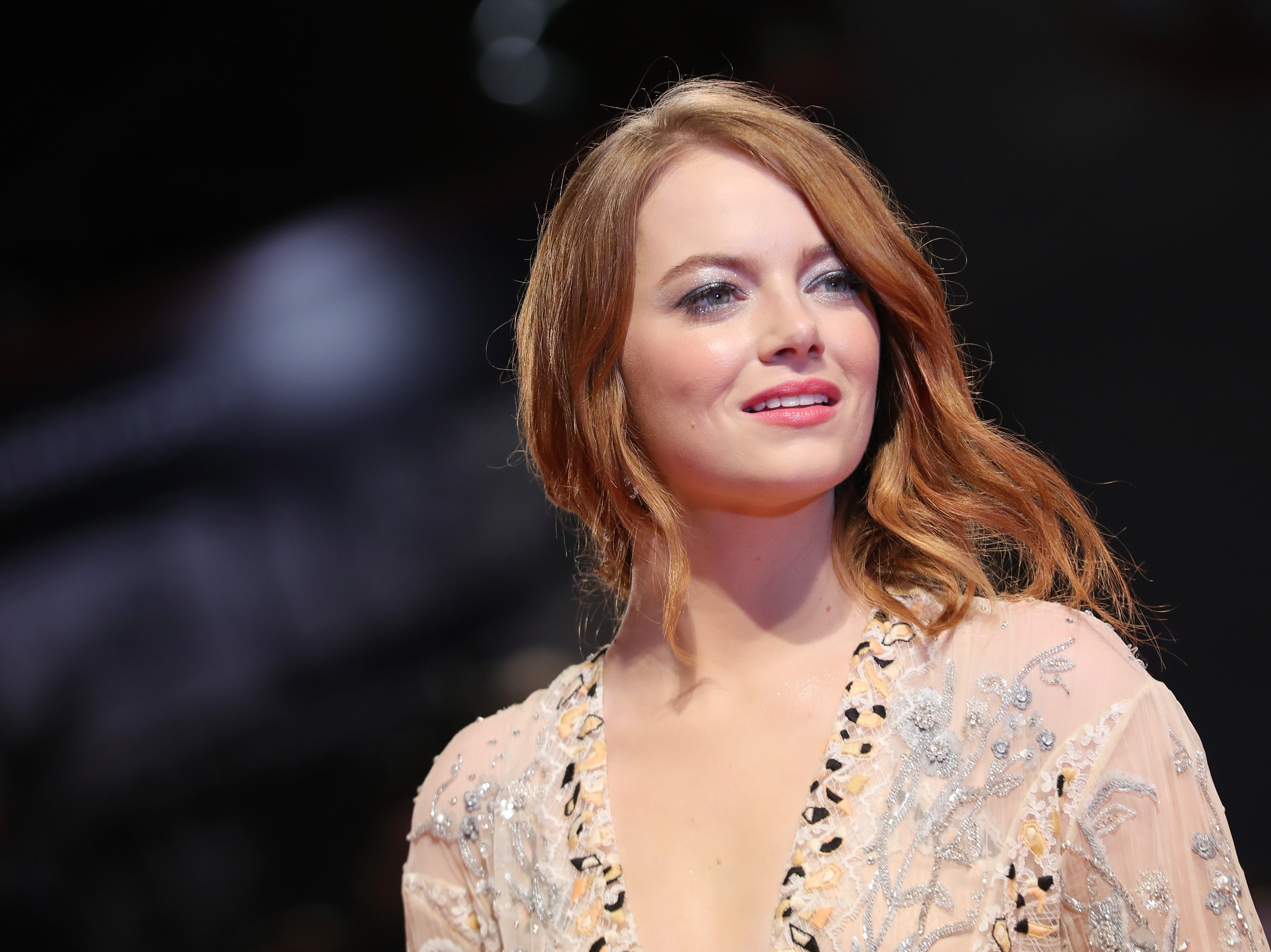 """Emma Stone plays Abigail Masham in """"the Favuorite,"""" one of two courtiers vying to be the favorite of Queen Anne in the early 18th century."""