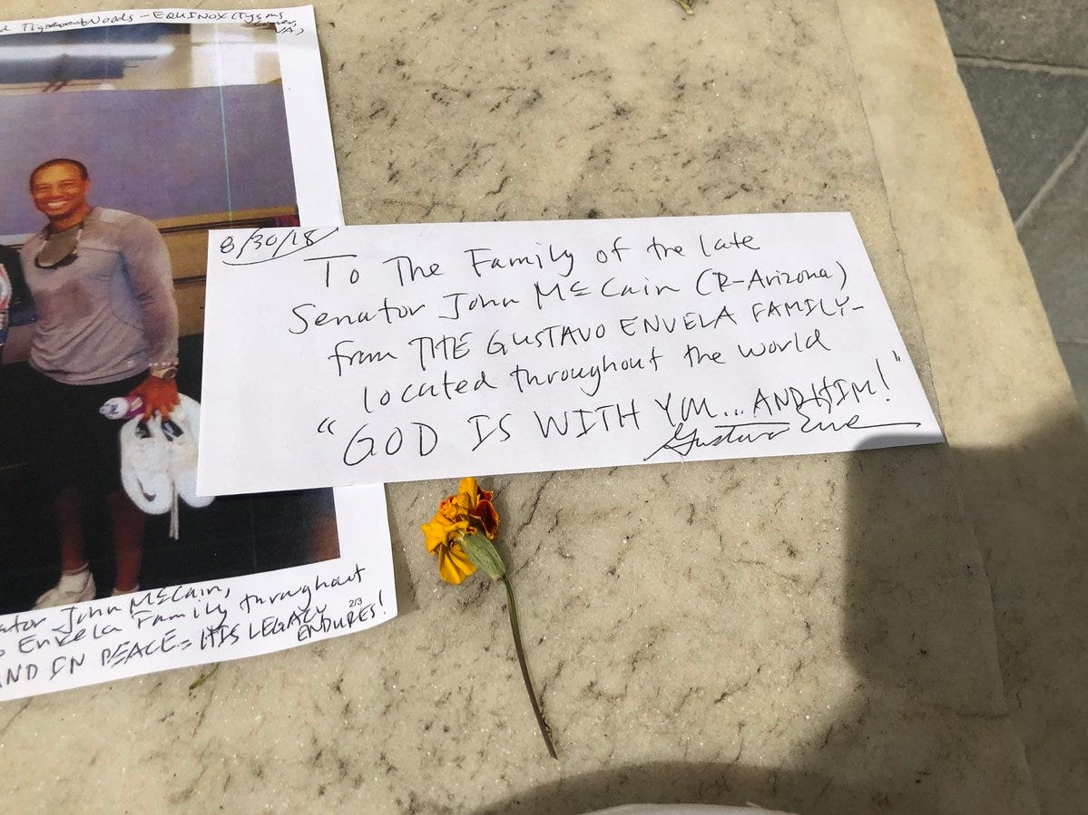 Outside the Russell building, there is makeshift memorial growing for Sen. John McCain. It includes an officer's hat, cards and messages honoring him