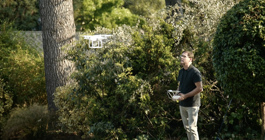 Sam Sargent uses a DJI drone to get aerial photographs of a home for sale in the Crocker Highlands neighborhood of Oakland.