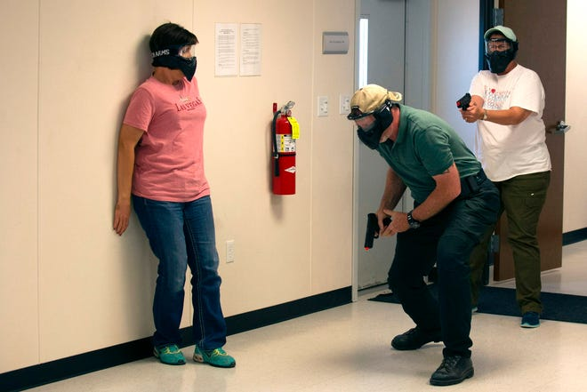 School teachers and administrators participate in an active shooter drill on June 28, 2018, in Commerce City, Colorado.