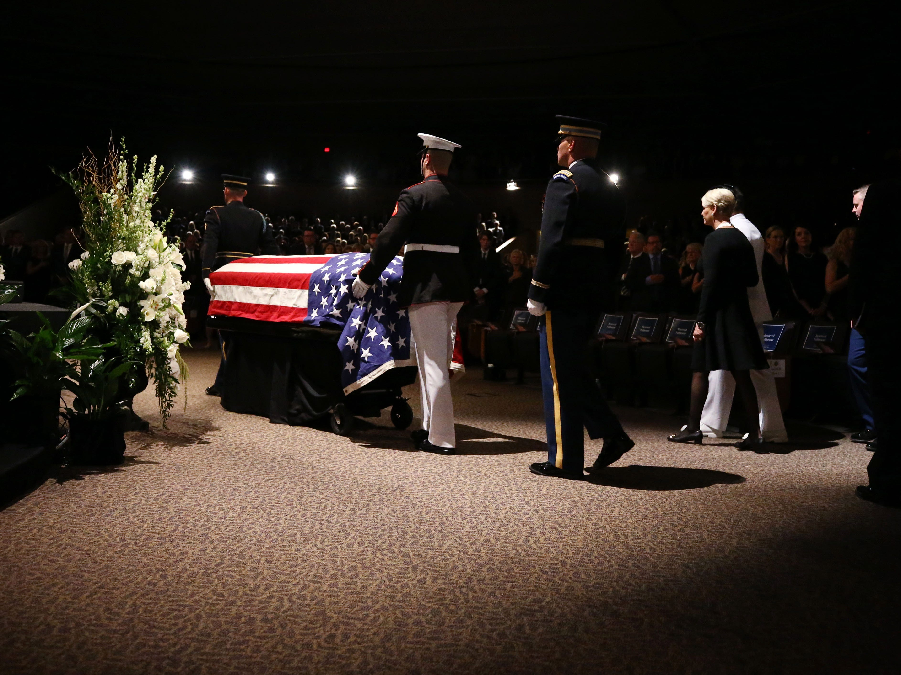 The flag draped casket of Sen. John McCain arrives at a memorial service at the North Phoenix Baptist Church, Aug. 30, 2018, in Phoenix.