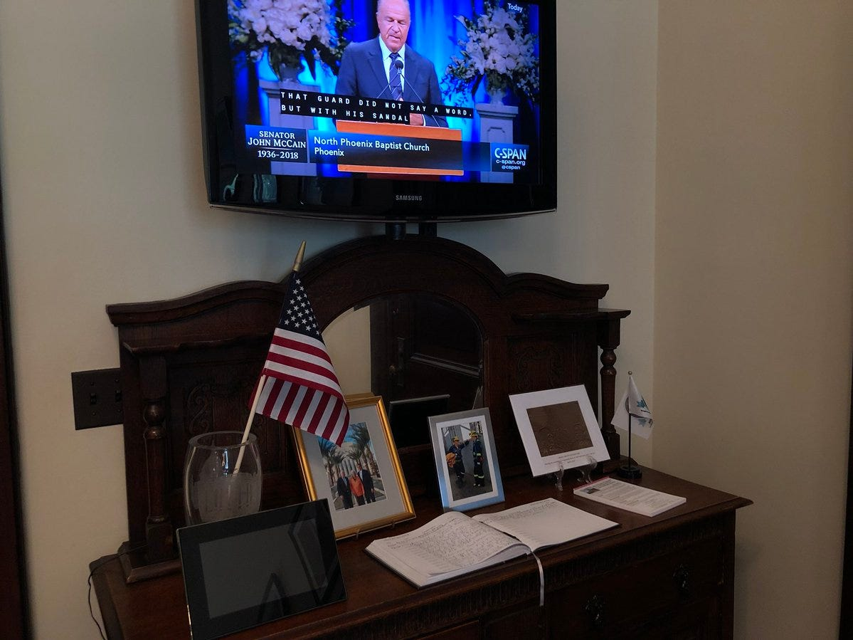 John McCain's staff in D.C. watched the Arizona ceremony.