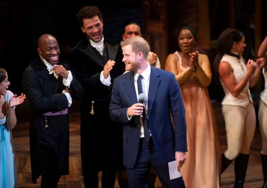Britain's Prince Harry addresses the audience after a gala performance of the musical Hamilton on Aug. 29, 2018.