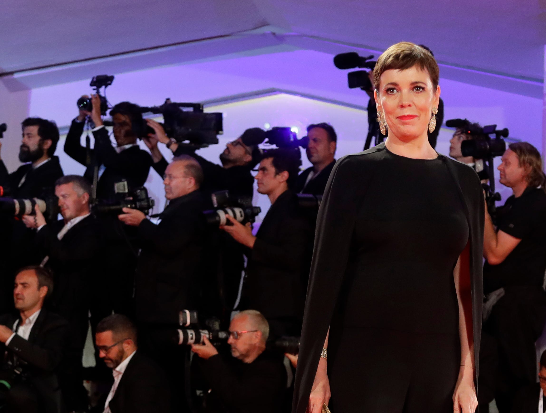 Actress Olivia Colman poses for photographers upon arrival at the premiere of the film 'The Favourite' at the 75th edition of the Venice Film Festival in Venice, Italy, Thursday, Aug. 30 , 2018.