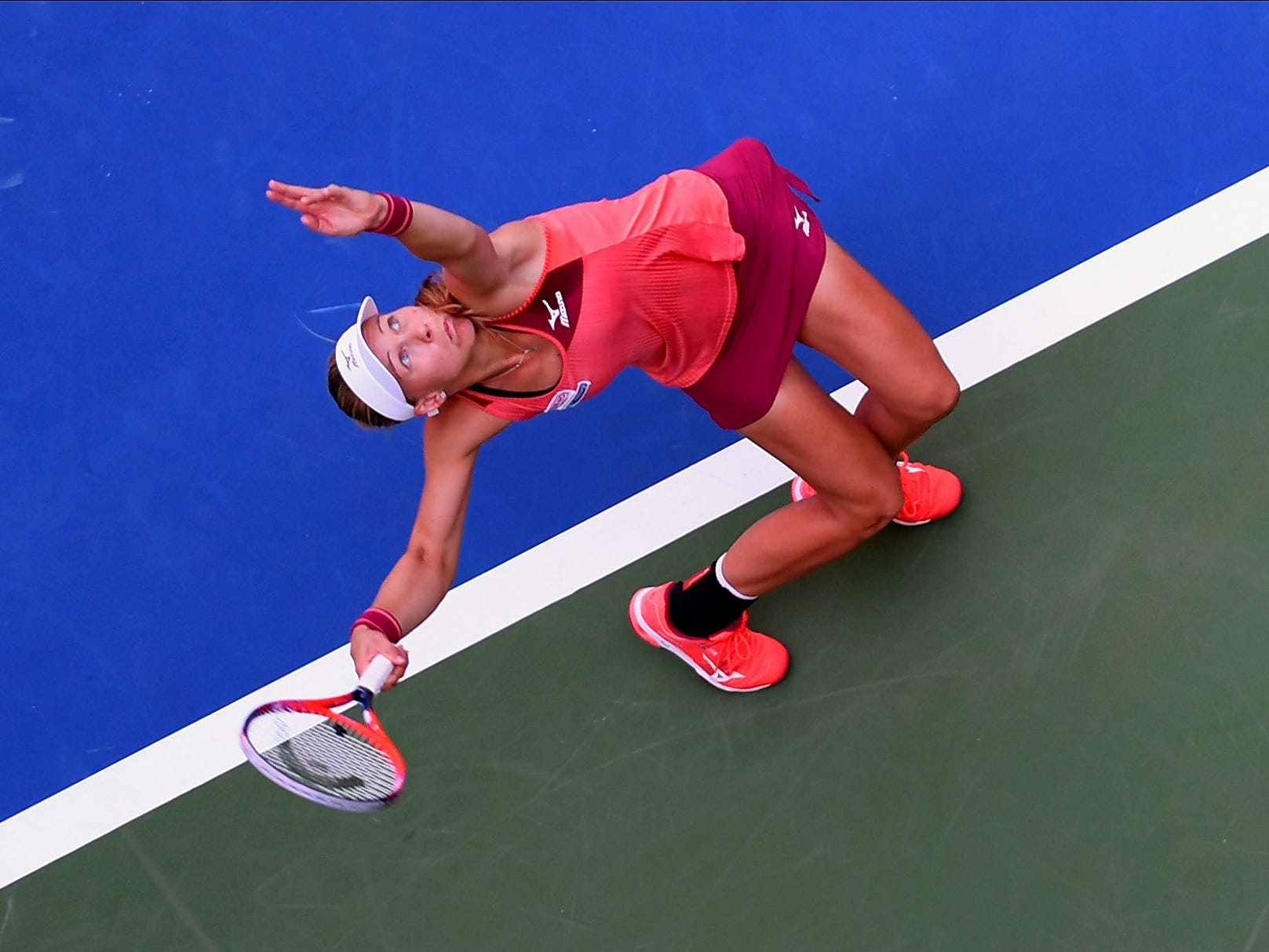 Johanna Larsson of Sweden serves to Angelique Kerber of Germany.