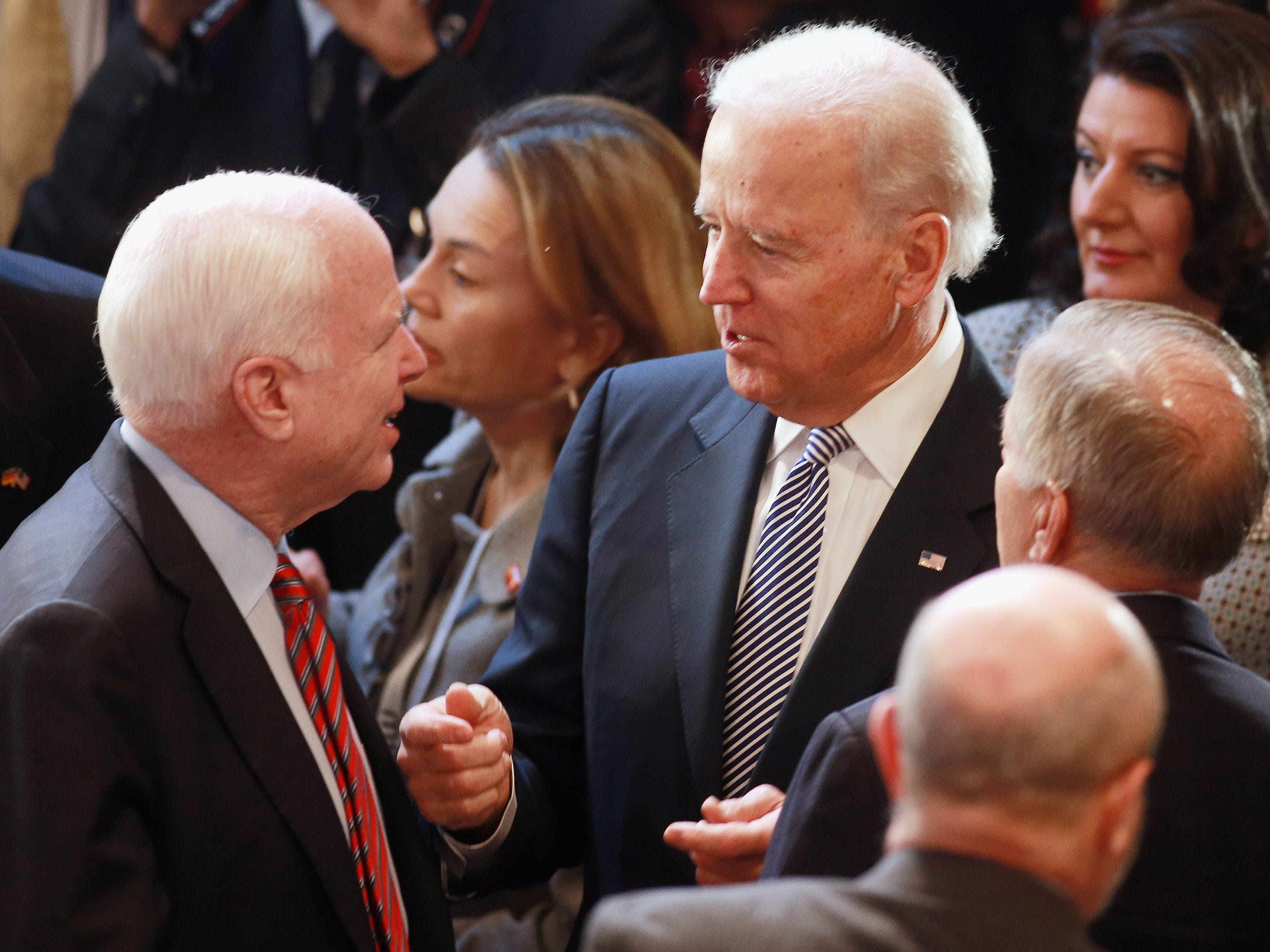 MUNICH, GERMANY - FEBRUARY 02:  U.S. Vice President Joe Biden (C) and U.S. senator John McCain (L) chat together during day 2 of the 49th Munich Security Conference at Hotel Bayerischer Hof on February 2, 2013 in Munich, Germany. The Munich Security Conference brings together senior figures from around the world to engage in an intensive debate on current and future security challenges and remains the most important independent forum for the exchange of views by international security policy decision-makers.  (Photo by Johannes Simon/Getty Images)
