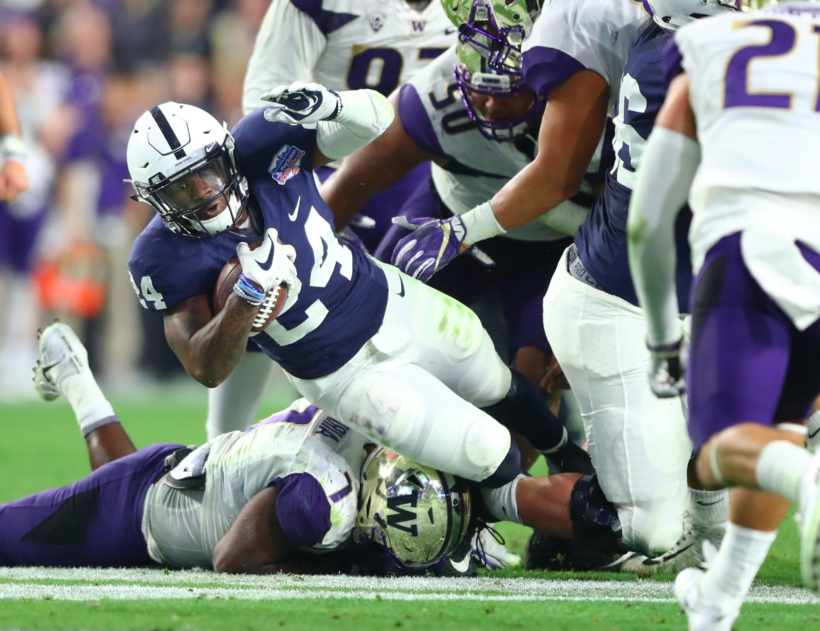 """Penn State running back Miles Sanders dives for yardage against the  Washington in the 2017 Fiesta. """" cba08b8f1"""